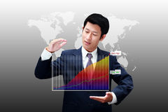 Business man holding a chart of business growth. With new high Stock Images