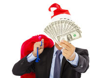 Business man holding a christmas gift bag and money Royalty Free Stock Image