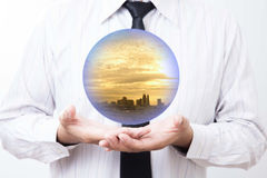 Business man holding a city inside a sphere, City of the future royalty free stock images