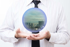 Business man holding a city inside a sphere, City of the future Stock Photos