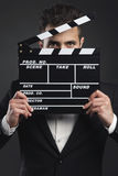 Business man holding a clapboard Stock Image