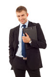 Business man holding a  clip board. Young business man holding a  clip board over white background Royalty Free Stock Photos