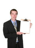 Business man holding clipboard Stock Photo