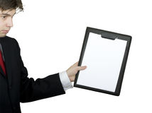 Business man holding clipboard Stock Photography