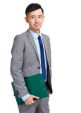 Business man holding clipboard Royalty Free Stock Image