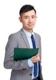 Business man holding clipboard Stock Photos