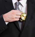 Business man holding a clock Royalty Free Stock Photography