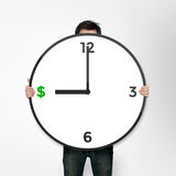 Clock with dollars icon Stock Photos