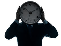 Business man holding clock silhouette Stock Photography