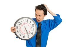 Business man holding clock stressed, pressured by lack of time Stock Photos