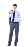 Business man holding coat over shoulders Royalty Free Stock Image