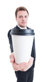 Business man holding a coffee to go Royalty Free Stock Image