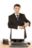 Business man holding a computer monitor. Isolated Stock Image