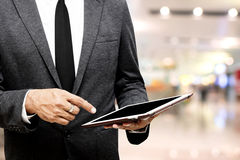 Business man holding computer tablet selective focus on pointing Stock Photo