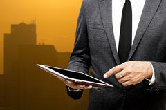Business man holding computer tablet selective focus on pointing Royalty Free Stock Photos