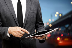 Business man holding computer tablet selective focus on pointing. Finger with traffic light backgrounds Stock Photo
