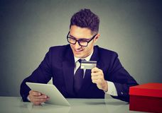 Business man holding credit card and using digital tablet. Online shopping royalty free stock images