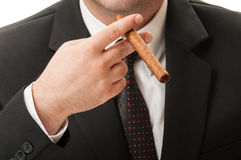 Business man holding a cuban cigar Royalty Free Stock Image