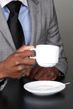 Business man holding a cup of coffee Royalty Free Stock Photos