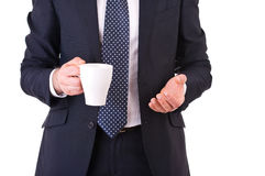 Businessman holding a cup of coffee. Stock Image