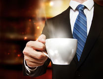 Business Man Holding a Cup of Coffee Royalty Free Stock Image