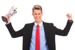 Business man holding a cup trophy over white Royalty Free Stock Photography