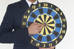 Business man holding dart success concept. On white background Royalty Free Stock Image