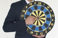Business man holding dart success concept. On white background Stock Photos