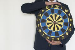 Business man holding dart success concept. On white background Stock Photography