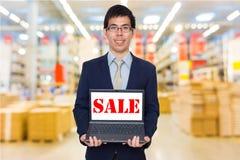 Business man holding digital laptop computer Stock Photos