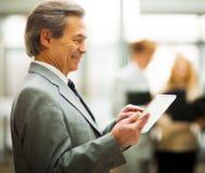 Business man holding digital tablet. Stock Image