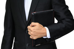 Business man holding digital tablet. PC with leather case isolated on white Stock Photo