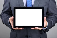 Business man holding digital tablet PC. Showing something on blank screen. Copyspace Stock Photography