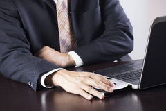 Business man holding Disk insert to laptop Royalty Free Stock Photo