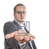 Business man holding a Disk Symbol Stock Photos