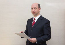 Business man holding a document Stock Image