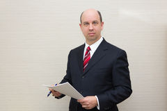 Business man holding a document Stock Photography