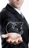 Business man holding a drawn piggy bank Royalty Free Stock Images