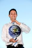 Business man holding earth Stock Photo