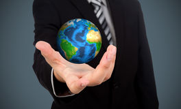Business man holding earth  (Elements of this image f Royalty Free Stock Photography
