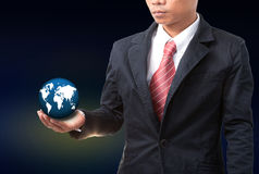Business man holding earth globe in hand Stock Photos