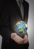 Business man holding earth in his hand Royalty Free Stock Photo