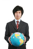 Business man holding earth with white background Stock Images