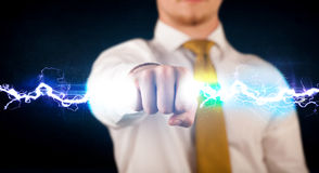 Business man holding electricity light bolt in his hands. Concept Royalty Free Stock Photo