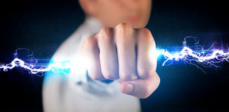 Business man holding electricity light bolt in his hands Royalty Free Stock Photos