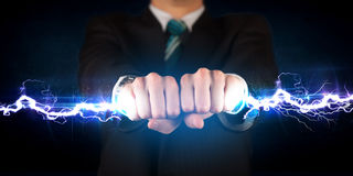Business man holding electricity light bolt in his hands Stock Photo