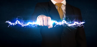 Business man holding electricity light bolt in his hands Royalty Free Stock Images