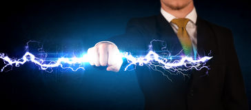 Business man holding electricity light bolt in his hands Stock Photos