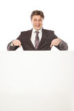 Business man holding empty board and pointing Royalty Free Stock Images