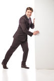 Business man holding empty board and pointing Stock Photo